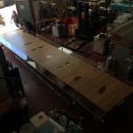 cast acrylic + wood Table- on work