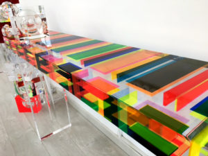 Colored lucite console table
